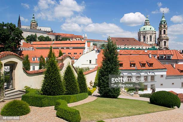 Czech Republic, Bohemia, Prague, The 18th Century Vrtba Gardens with St Vitus Cathedral in Prague castle to the left and the Church of St Nicholas on...