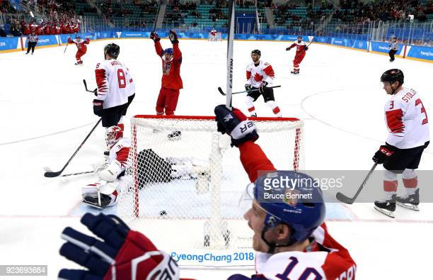 Czech Republic celebrate after scoring a goal in the first period against Kevin Poulin of Canada during the Men's Bronze Medal Game on day fifteen of...