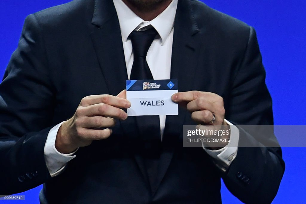 Czech Republic former football player Vladimir Smicer shows the name of Wales during the UEFA Nations League draw at the headquarters of the European football organisation in Lausanne, on January 24, 2018. /
