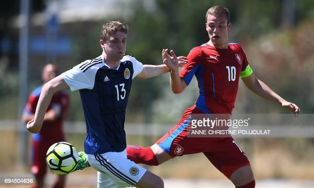 Czech' Republic forward Onderj Sasinka vies with Scotland's midfielder Iain Wilson during the Under 21 international football third place match Czech...