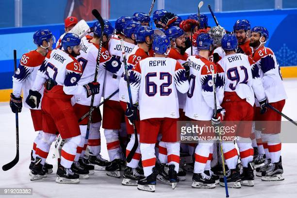 Czech Republic players celebrate after winning the men's preliminary round ice hockey match between Canada and Czech Republic during the Pyeongchang...
