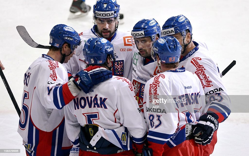 Czech Republic players celebrate scoring during the Ice hockey Euro Hockey Tour's Channel One Cup match Finland vs Czech Republic in Helsinki on December 13, 2012.