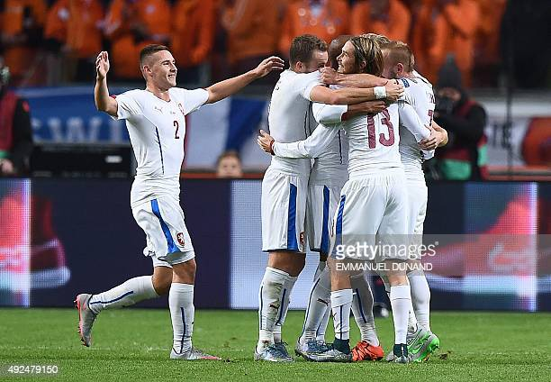 Czech Republic players react after scoring their third goal during the Euro 2016 qualifying fooball match Netherlands vs Czech Republic at the...