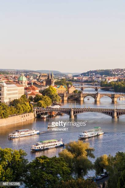 czech republic, prague, cityscape with charles bridge and boats on vltava - vltava river stock photos and pictures