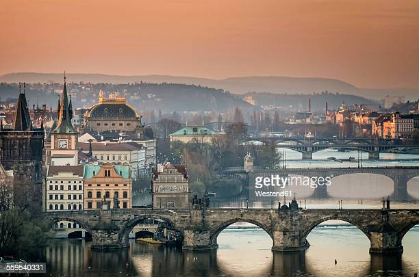 czech republic, prague, cityscape with charles bridge at dawn - charles bridge stock photos and pictures