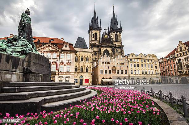 Czech Republic, Prague, Monument with flowerbed on old town square