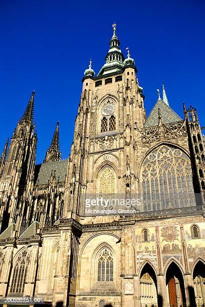 czech republic, prague, st vitus's cathedral clock tower, low angle - st vitus's cathedral stock pictures, royalty-free photos & images