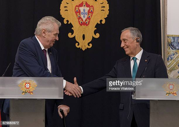 Czech Republic President Milos Zeman and Portuguese President Marcelo Rebelo de Sousa shake hands during their press conference at the end of their...