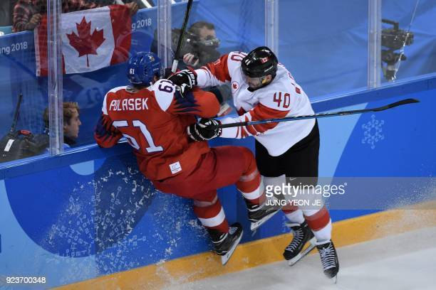Czech Republic's Adam Polasek and Canada's Maxim Lapierre collide in the men's bronze medal ice hockey match between the Czech Republic and Canada...