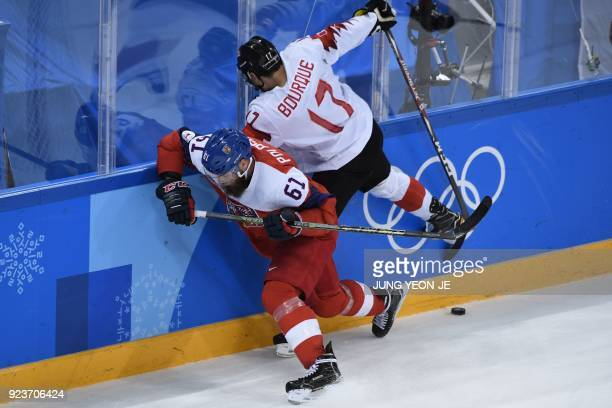 Czech Republic's Adam Polasek and Canada's Rene Bourque collide in the men's bronze medal ice hockey match between the Czech Republic and Canada...
