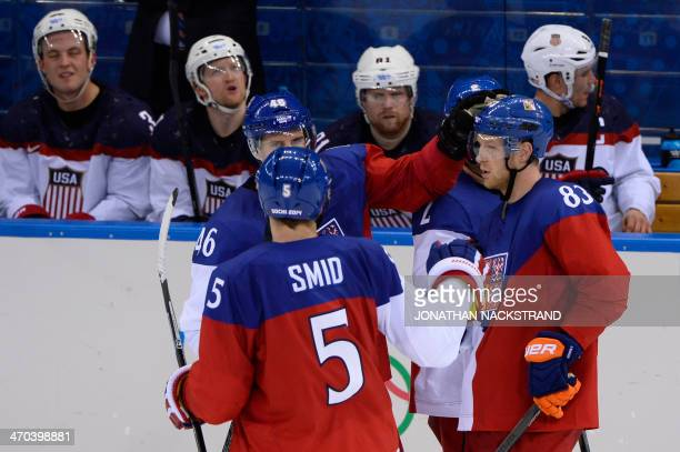Czech Republic's Ales Hemsky is congratulated by teammates after scoring a goal during the Men's Ice Hockey Quarterfinals match between the USA and...