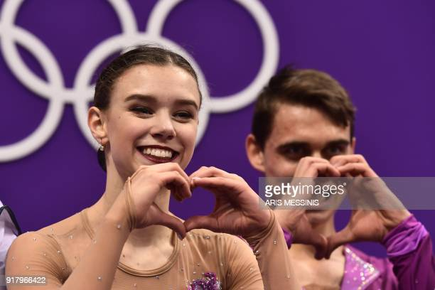 Czech Republic's Anna Duskova and Czech Republic's Martin Bidar react after competing in the pair skating short program of the figure skating event...