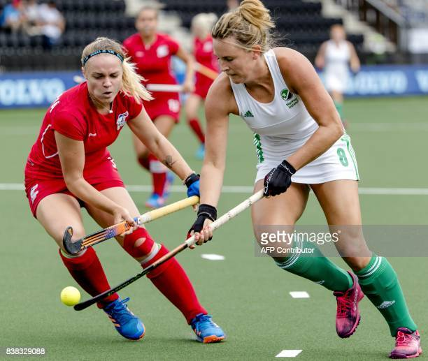 Czech Republic's Anna Kolarova vies with Ireland's Nicola Evans during the Women's Hockey Rabo EuroHockey Championships in Amstelveen on August 22...