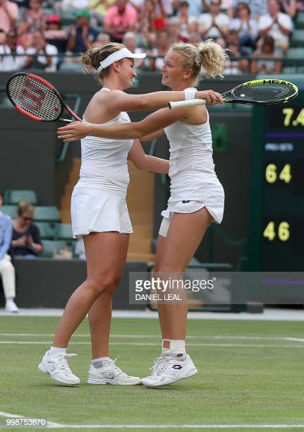 Czech Republic's Barbora Krejcikova and Czech Republic's Katerina Siniakova reacts after winning against Nicole Melichar of the USA and Czech...
