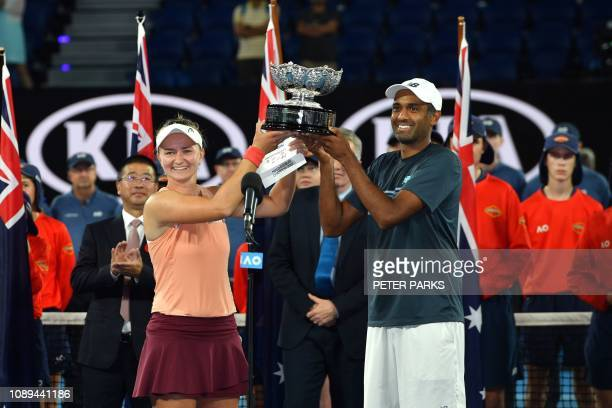 Czech Republic's Barbora Krejcikova and Rajeev Ram of the US celebrate with the trophy after defeating Australia's Astra Sharma and JohnPatrick Smith...