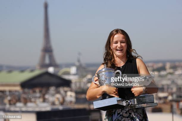 Czech Republic's Barbora Krejcikova poses with her two trophies in front of the Eiffel tower, on June 14, 2021 in Paris, during a photocall one day...