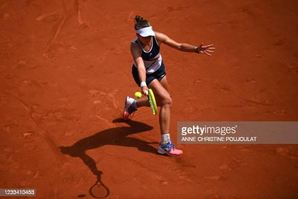 Czech Republic's Barbora Krejcikova returns the ball to Russia's Anastasia Pavlyuchenkova during their women's singles final tennis match on Day 14...