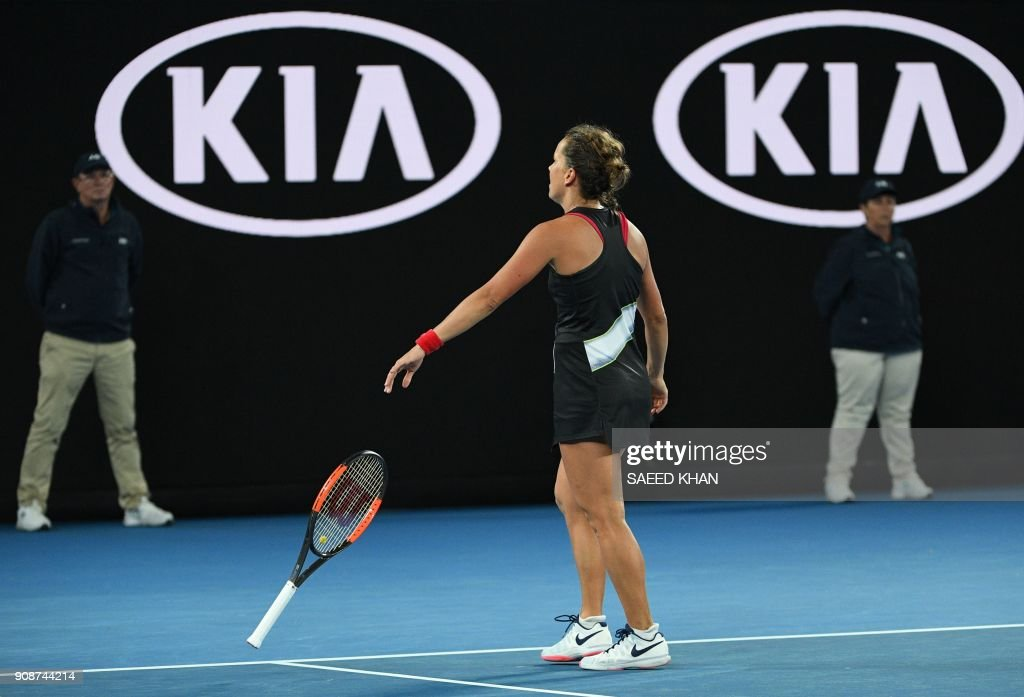 Czech Republic's Barbora Strycova catches her racquet as she reacts after a point during her women's singles fourth round match against Czech Republic's Karolina Pliskova on day eight of the Australian Open tennis tournament in Melbourne early January 23, 2018. /