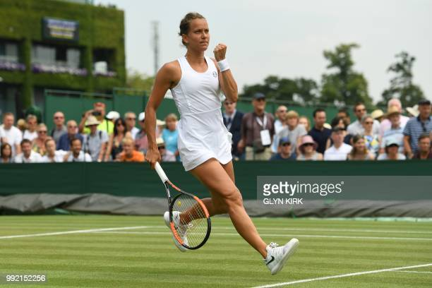 Czech Republic's Barbora Strycova celebrates winning a point against Ukraine's Lesia Tsurenko during their women's singles second round match on the...