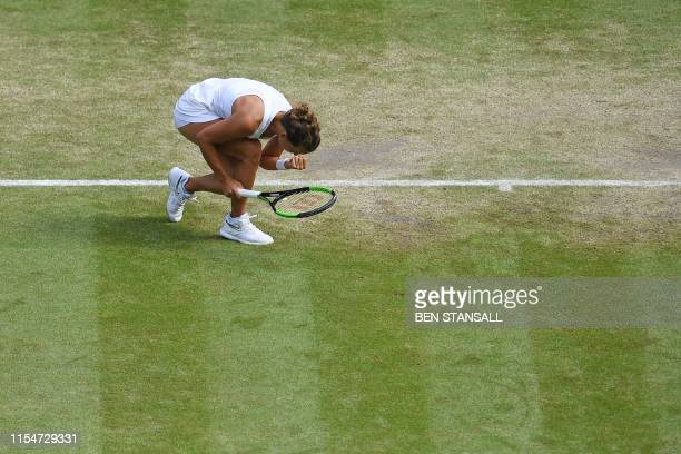 TOPSHOT Czech Republic's Barbora Strycova celebrates winning a point in the first set against Britain's Johanna Konta during their women's singles...
