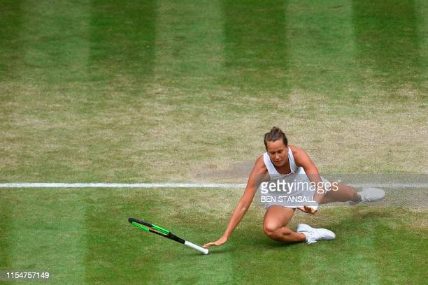 TOPSHOT Czech Republic's Barbora Strycova falls during a point against Britain's Johanna Konta during their women's singles quarterfinal match on day...