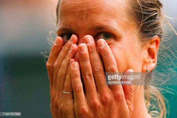 Czech Republic's Barbora Strycova puts her hands to her face as she celebrates beating Britain's Johanna Konta during their women's singles...