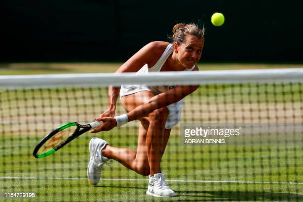 TOPSHOT Czech Republic's Barbora Strycova returns against Britain's Johanna Konta during their women's singles quarterfinal match on day eight of the...