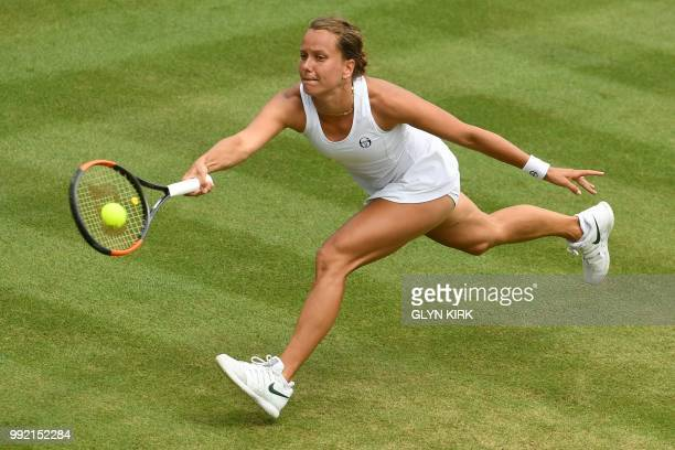Czech Republic's Barbora Strycova returns against Ukraine's Lesia Tsurenko during their women's singles second round match on the fourth day of the...