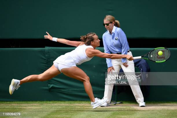 Czech Republic's Barbora Strycova returns against US player Serena Williams during their women's singles semi-final match on day ten of the 2019...