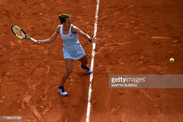 Czech Republic's Barbora Strycova returns the ball to Australia's Samantha Stosur during their women's singles first round match on day two of The...