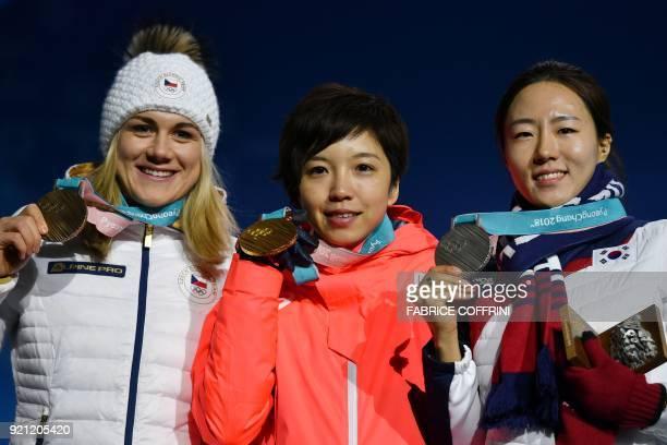Czech Republic's bronze medallist Karolina Erbanovab Japan's gold medallist Nao Kodaira and South Korea's silver medallist Lee SangHwa pose on the...