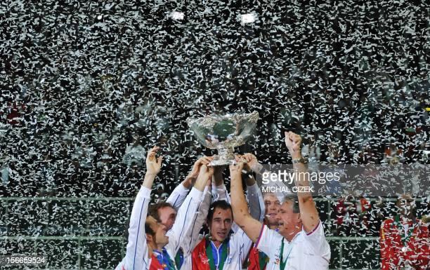 Czech Republic's Davis Cup Team Radek Stepanek, Ivo Minar, Lukas Rosol, Toams Berdych and captain Jaroslav Navratil pose with the trophy after the...
