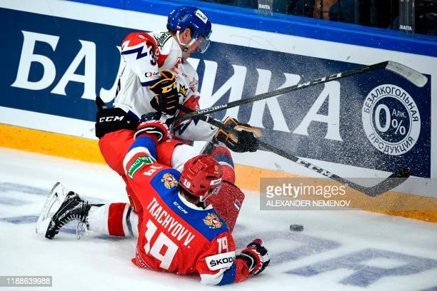 Czech Republic's defender Jakub Krejcik vies with Russian forward Vladimir Tkachyov during the Channel One Cup of the Euro Hockey Tour ice hockey...
