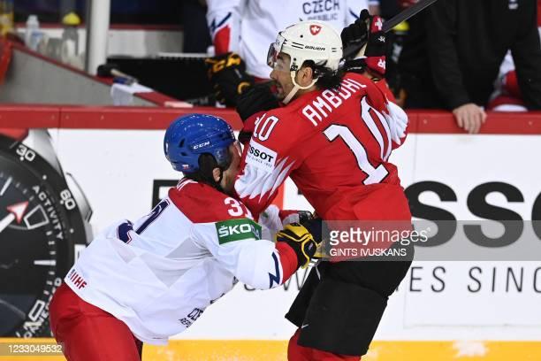 Czech Republic's defender Lukas Klok and Switzerland's forward Andres Ambuhl vie during the IIHF Men's Ice Hockey World Championships preliminary...