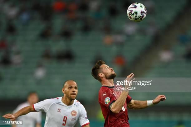 Czech Republic's defender Ondrej Celustka fights for the ball with Denmark's forward Martin Braithwaite during the UEFA EURO 2020 quarter-final...