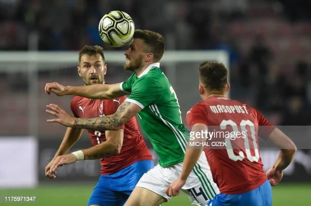 Czech Republic's defender Radim Reznik and Czech Republic's midfielder Lukas Masopust vie for a ball with Northern Ireland's midfielder Stuart Dallas...