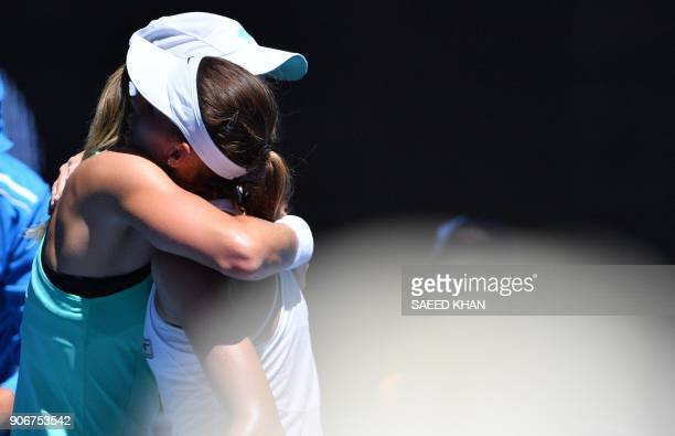 Czech Republic's Denisa Allertova hugs Poland's Magda Linette after their women's singles third round match on day five of the Australian Open tennis...
