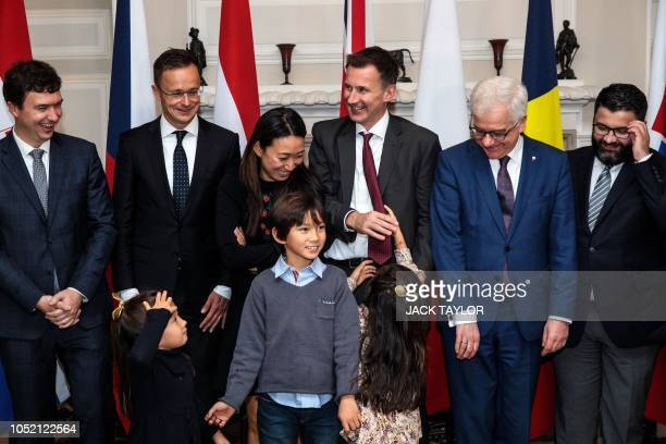 Czech Republic's Deputy Foreign Minister Lukas Kaucky, Hungary's Foreign Minister Peter Szijjarto, Lucia Hunt, her husband Britain's Foreign...