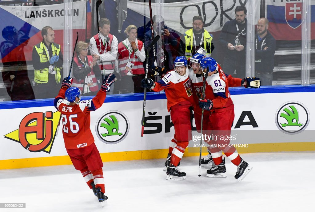 Czech Republic's Dmitrij Jaskin (2nd R) is congratulated by teamates after scoring the game-winning goal during the 2018 IIHF Men's Ice Hockey World Championship match between Czech Republic and Slovakia on May 5, 2018 in Copenhagen.