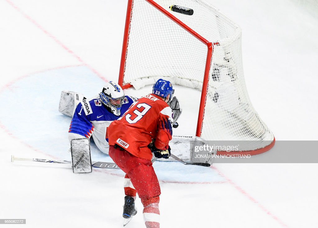 Czech Republic's Dmitrij Jaskin (front C) strikes to score the game-winning goal past Slovakia's goalie Marek Ciliak (rear C) during the 2018 IIHF Men's Ice Hockey World Championship match between Czech Republic and Slovakia on May 5, 2018 in Copenhagen.
