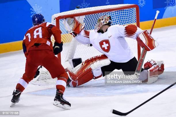 Czech Republic's Dominik Kubalik scores past Switzerland's Jonas Hiller in the men's preliminary round ice hockey match between the Czech Republic...
