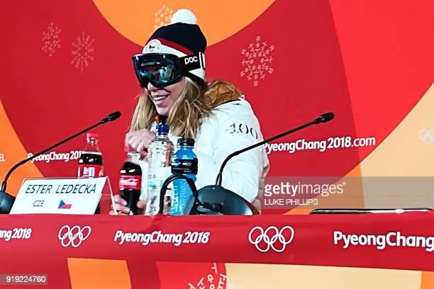TOPSHOT Czech Republic's Ester Ledecka keeps her goggles on during a press conference after winning the Women's SuperG at the Jeongseon Alpine Center...