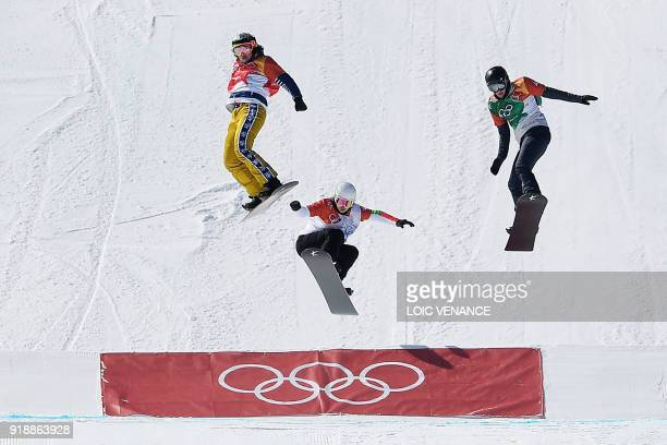 Czech Republic's Eva Samkova competes during the women's snowboard cross semi-final at the Phoenix Park during the Pyeongchang 2018 Winter Olympic...