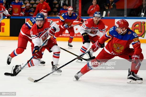 TOPSHOT Czech Republic's forward David Pastrnak vies with Russia's defender Bogdan Kiselevich during the IIHF Men's World Championship quarter final...