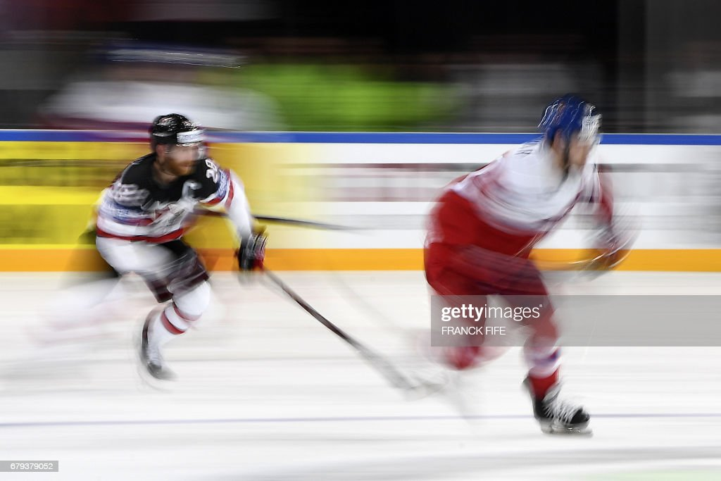 Czech Republic's forward Jan Kovar (R) challenges Canada's forward Claude Giroux during the IIHF Men's World Championship group B ice hockey match between the Czech Republic and Canada in Paris on May 5, 2017. /