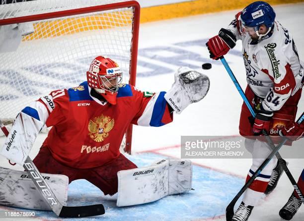 Czech Republic's forward Jiri Sekac attacks Russia's goalkeeper Ilya Sorokin during the Channel One Cup of the Euro Hockey Tour ice hockey match...