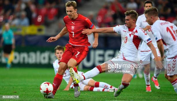 Czech Republic's forward Lukas Julis and Denmark's defender Andreas Maxsoe vie for the ball during the UEFA U21 European Championship Group C...