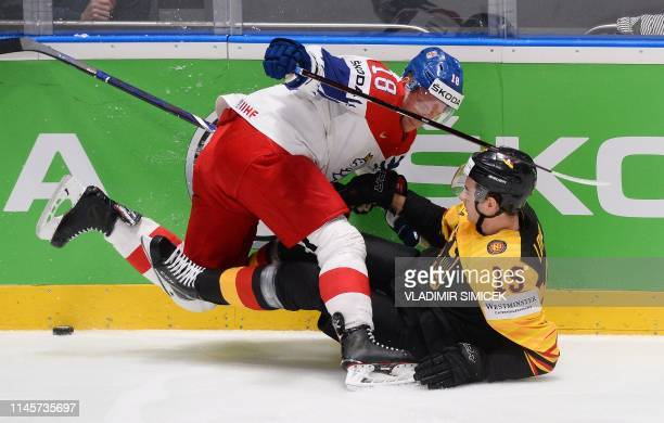 Czech Republic's forward Ondrej Palat and Germany's forward Stefan Loibl vie for the puck during the IIHF Men's Ice Hockey World Championships...