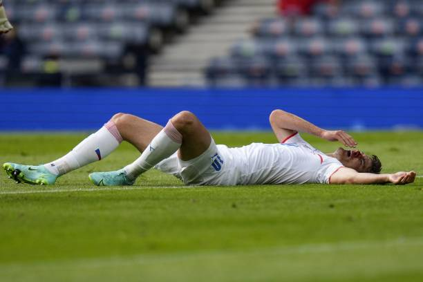 Czech Republic's forward Patrik Schick lies on the pitch after being hit on the face during the UEFA EURO 2020 Group D football match between Croatia...