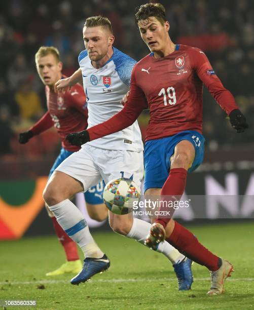 Czech Republic's forward Patrik Schick scores next to Slovakia's defender Milan Skiniar during the UEFA Nations League football match Czech Republic...